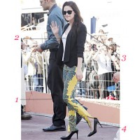 Kristen Stewart looking hot in Balenciaga pants, tuxedo jacket, white tank and black pumps.