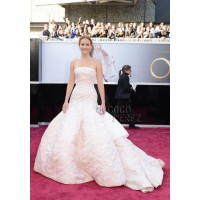 Well, this Dior dress has been compared to a toilet roll holder and a bedspread. We think that's a bit harsh. Especially when worn by someone as lovely as Jennifer Lawrence. Source: http://oscar.go.com/red-carpet/photos/85th/red-carpet/womens-fashion-20