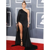 It's heartening to see someone advancing the Thigh Pride movement, (started about this time last year by Angelina Jolie). J-lo wears Anthony Vaccarello gown with Tom Ford sandals. Via hollywoodreporter.com