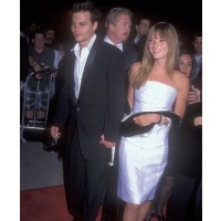 Kate Moss with Johnny Depp credit: Getty/BarryKing http://www.fabsugar.co.uk/Kate-Moss-Best-Fashion-Moments-Photos-33510910?slide=2&image_nid=33511834