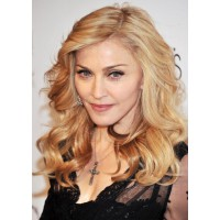 Madge's medium bouncy waves. Picture of Madonna Trendy Medium Wavy Hair Styles/Getty Images http://pophaircuts.com/madonna-trendy-medium-wavy-hair-styles
