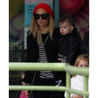 Nicole Richie rocks a mod look and red beanie during a day with the kids. source: Socialite Life credit: Fame http://socialitelife.com/photos/nicole-richie-is-ready-to-test-new-hubby-joel-madden/rain-and-cold-weather-cant-keep-nicole-richies-kids-down-8