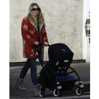 Sienna Miller pushes baby Marlowe while in a divine red vintage coat. source: Hello magazine online credit: hellomagazine.com http://www.hellomagazine.com/celebrities/gallery/2012121810516/sienna-miller-baby-marlowe/1/