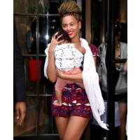 Beyonce rocks a printed playsuit on an outing at Bergdorfs with baby Blue Ivy. source: mydaily.co.uk credit: Rex Features http://www.mydaily.co.uk/2012/07/19/beyonce-blue-ivy-picture_n_1685250.html