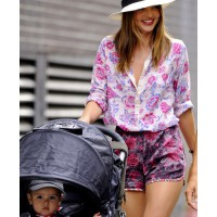Miranda Kerr in sunny florals while taking Flynn out for a stroll. source: Zimbio credit: Pacific Coast News http://www.zimbio.com/pictures/IZ7Ef0XSUW7/Miranda+Kerr+Flynn+Out+NYC/9QnT0Xn_hth