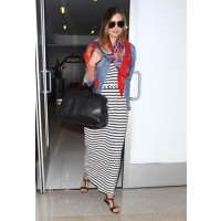 Miranda Kerr lands in style at LAX. Source: FameFlynet via Fabsugar. http://www.fabsugar.com/photo-gallery/31382466/Miranda-Kerr-punched-up-LAX-her-striped-maxi-dress-colorful-printed-scarf-denim-jacket/