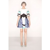 Nicola Finetti Floral Zig-Zag Cape Dress, $480. http://www.nicolafinetti.com/eboutique/collections/1040-floral-zig-zag-cape-dress.html
