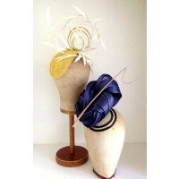 Murley & Co Millinery Yellow Closefit Teardrop with White Paper Feathers (left) and Blue Silk Abaca Twist and Musk Quill on Natural Sinamay Base with Navy Satin (right), $310 each. http://www.murleyandco.com/#!ready-to-wear-gallery/c22j5