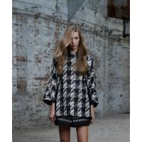 Scanlan Theodore Houndstooth Weave Cocoon Coat, $850. http://www.scanlantheodore.com/coats/c39701-houndstooth-weave-cocoon-coat