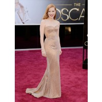 Zero Dark Thirty star Jessica Chastain exudes old-world glamour in a shimmering strapless Armani Prive gown and Harry Winston jewels, finished off with a slick of red lippy. Source: Glamour.com http://www.glamour.com/fashion/blogs/slaves-to-fashion/2013/0