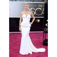 A picture of peplum perfection, Charlize Theron looks sublime in Dior Haute Couture and Harry Winston jewellery. The starlet's chic pixie haircut adds edge, too. Source: Glamour.com http://www.glamour.com/fashion/blogs/slaves-to-fashion/2013/02/oscars-201