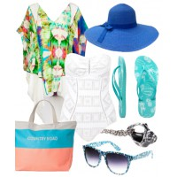 Sun-kissed style: A wide-brimmed hat adds a touch of glamour to cool beach attire.