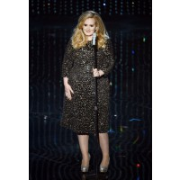 As Adele proved on stage when performing her hit song 'Skyfall', you can't put a fashionable foot wrong when wearing a chic black dress, teamed with sparkly silver accents. Source: Kevin Winter/Getty Images via LaineyGossip.com http://www.laineygossip.com