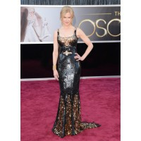 Our Nic puts her fashion where she puts her Black and Gold self-raising, straight onto the cash and carry. What I mean to say is she looks awesome in L'Wren Scott. Source: http://oscar.go.com/red-carpet/photos/85th/red-carpet/womens-fashion-20