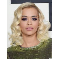 Rita Ora matches her blonde hair and green dress with a dramatic purple smokey eye. Image via http://www.huffingtonpost.com/2014/01/26/grammy-awards-2014-hair-makeup-photos_n_4666265.html?ref=topbar