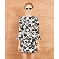 Karen Walker at Precious Peg find it here http://www.preciouspeg.com/clothing/dresses/frill-cuff-dress-by-karen-walker-4864.html#.UgDzANJ-5XE