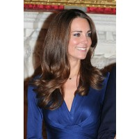 The big, generous flicks seen at her engagement announcement interview. Image via http://www.glamourmagazine.co.uk/beauty-and-hair/beauty-features/2012/01/kate-middleton-hair-get-the-look-ghd#!image-number=10