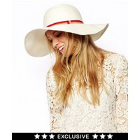 ASOS Wide Brim Straw Hat with Multi Ribbon $78.43 http://www.asos.com/au/Catarzi/Catarzi-Exclusive-to-ASOS-Wide-Brim-Straw-Hat-With-Multi-Ribbon/Prod/pgeproduct.aspx?iid=3900744&SearchQuery=wide%20brimmed%20hat&sh=0&pge=0&pgesize=36&sort=-1&clr=Offwhite