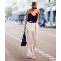 Kenza Zouiten proves there's nothing more chic than a white wide-leg pant. http://kenzas.se