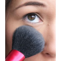 Use a fluffy powder brush as it will be gentler on the area around your eyes.