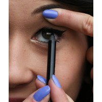 Gently pull back your eyelid to get the best angle for applying your pencil liner.
