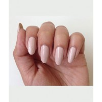 With Floss Gloss 'Pony', use a striper brush to draw different 70s-inspired geometric lines on each nail, thickening the line in the curves. Think oblongs with rounded corners.