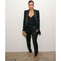 Image via WireImage http://www.dailymail.co.uk/tvshowbiz/article-2600387/Kim-Kardashian-sports-blazer-harem-pants-political-event-resist-flashing-cleavage-plunging-top.html