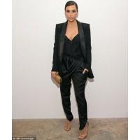 Image via WireImage http://www.dailymail.co.uk/tvshowbiz/article-2600387/Kim-Kardashian-sports-blazer-harem-pants-political-event-resist-flashing-cleavage-plunging-top.html