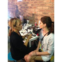 Mia Hawkswell beautifying a model with her expert touch.