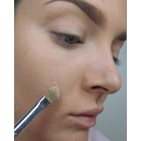 Dab concealer on with a brush or cotton bud.