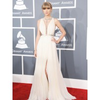 Taylor Swift in a J. Mendel gown, looking like she's just been dumped, and man is she annoyed! She has a good mind to take that dude down a peg or two by writing a vengeful tune about him... or something like that . Via hollywoodreporter.com