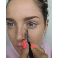 The blue/grey of under-eye circles can be counteracted by warm pink or salmon concealer.