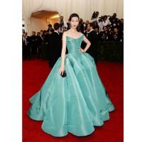 Liu Wen in Zac Posen dress - http://www.whowhatwear.com/met-gala-ball-red-carpet-fashion-2014/slide23